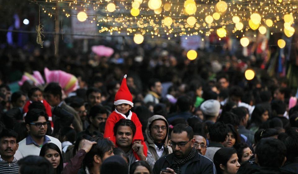 People enjoy Christmas at the Janpath Market in New Delhi.