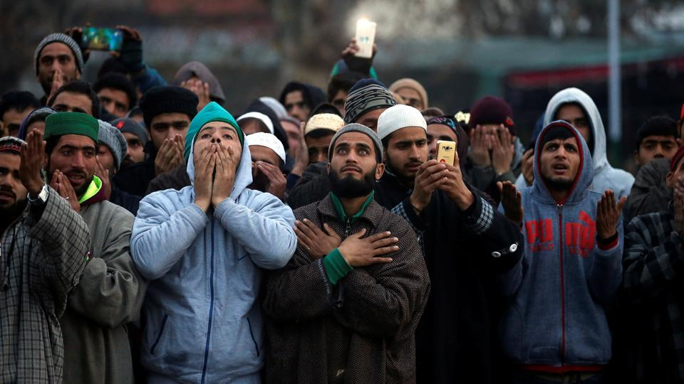 Kashmiri Muslim men pray upon seeing a relic believed to be a hair from the beard of Prophet Mohammad, being displayed during the festival of Eid-e-Milad-ul-Nabi, the birthday anniversary of the prophet, at Hazratbal shrine in Srinagar. (Danish Ismail  / REUTERS)
