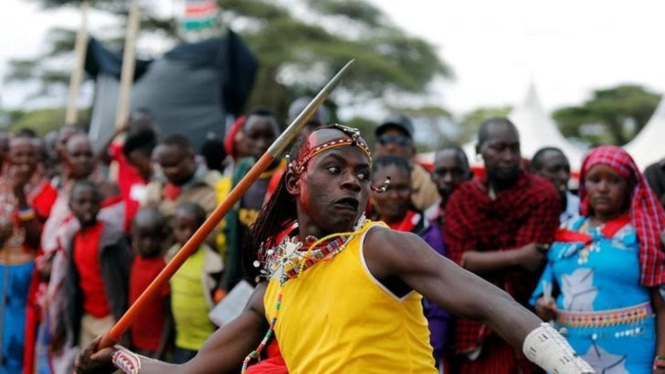 Njama Tipis, a Maasai moran from Rombo Manyatta, competes in the 2016 Maasai Olympics at the Sidai Oleng Wildlife Sanctuary, at the base of Mt. Kilimanjaro, near the Kenya-Tanzania border in Kimana, Kajiado, Kenya on December 10.
