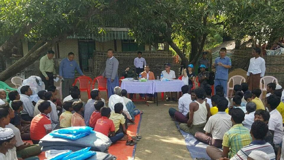 In this handout photograph released by Myanmar state counsellor office on Sunday shows Muslim minority residents of Maungdaw located in Rakhine State gathering to received humanitarian aid from UNHCR officiated by Rakhine State officials and UNHCR officials on December 9, 2016. Myanmar has called an emergency ASEAN meeting to discuss the Rohingya crisis, a diplomat said on December 12, 2016, as regional tensions rise over a bloody military crackdown on the Muslim minority.