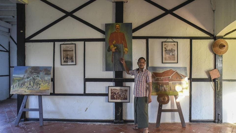 Amateur George Orwell scholar Nyo Ko Naing points to a portrait of a former British colonial official inside a planned museum in Katha, Myanmar.