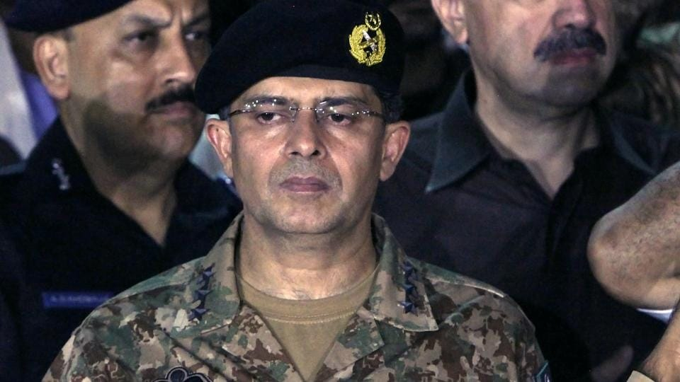 Lt. Gen Naveed Mukhtar attends a funeral in Karachi in July.