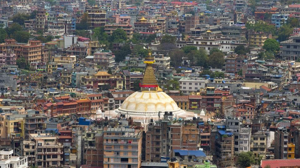 File photo from April 2015 shows the Boudhanath Stupa (center) amongst buildings four days after the April 25 earthquake in Kathmandu.