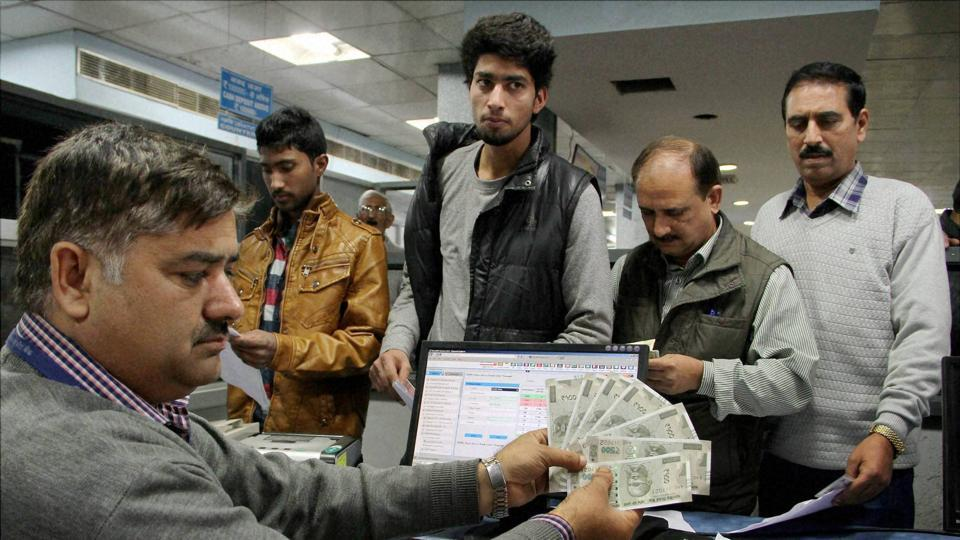 A bank official displays the new Rs 500 currency notes in a bank in Jammu.