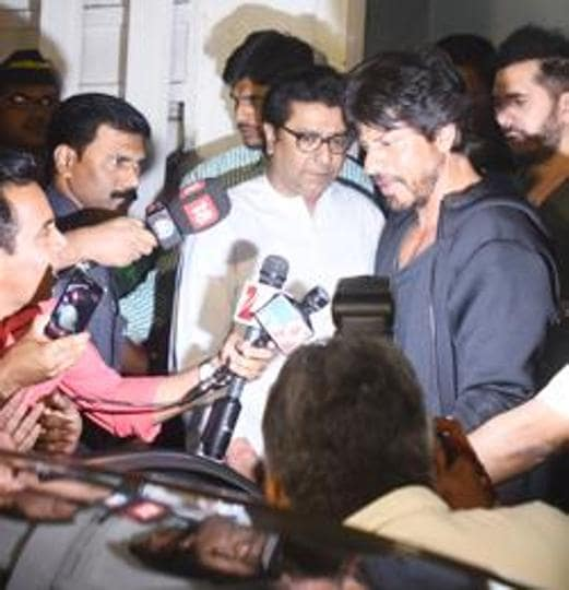 Actor Shah Rukh Khan with MNS chief Raj Thackeray (left) outside his house on Sunday.