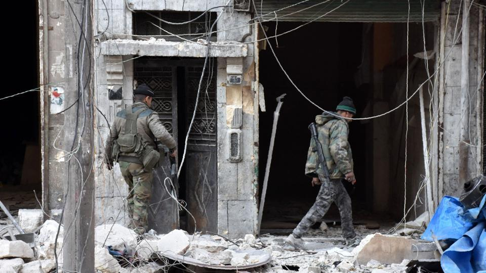 Syrian pro-government forces inspect a building in al-Maadi district of eastern Aleppo after they retook a large part of it from rebel fighters.