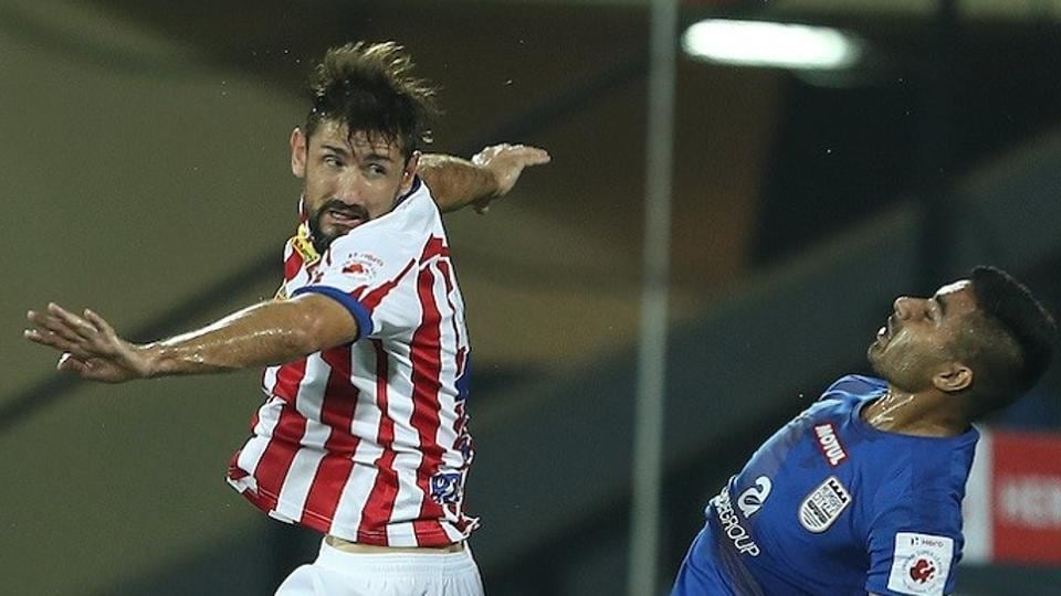 Atletico de Kolkata and Mumbai City FC players vie for the ball in the Indian Super League semifinal.