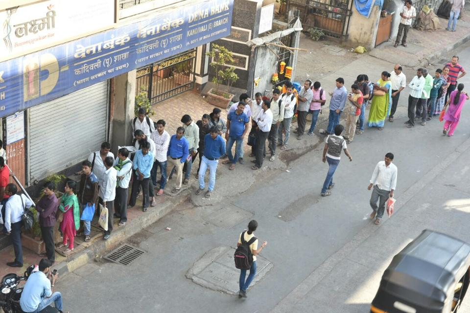 People stand in queue at around 8.30am in Kandivli to withdraw money.