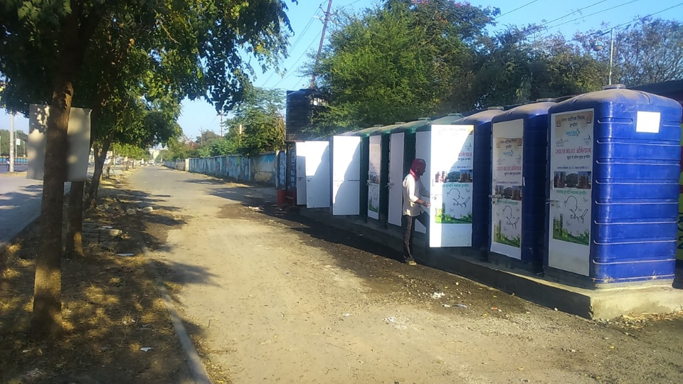 A man uses public toilet built by Indore Municipal Corporation near Bhawarkuwa area.