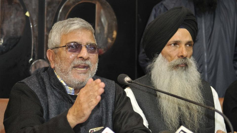 Dharamvira Gandhi and Punjab Front fellow leader Manjit Singh at a press conference in Chandigarh on Tuesday, December 13.