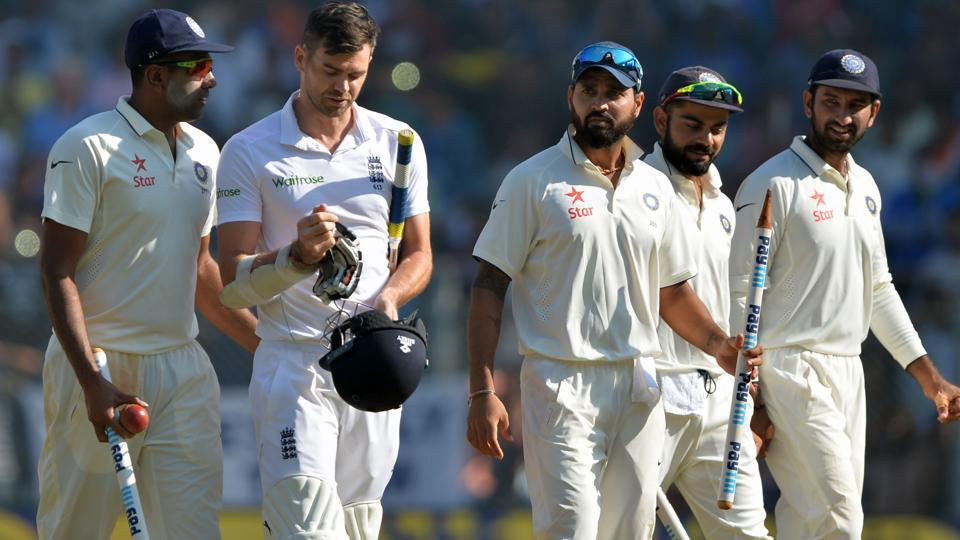 Ravichandran Ashwin (left) speaks with England's James Anderson (2nd Left) as India's Murali Vijay (Centre), captain Virat Kohli (2nd R) and Cheteshwar Pujara (R) watch after India won the fourth Test cricket match against England at the Wankhede Stadium in Mumbai on December 12.