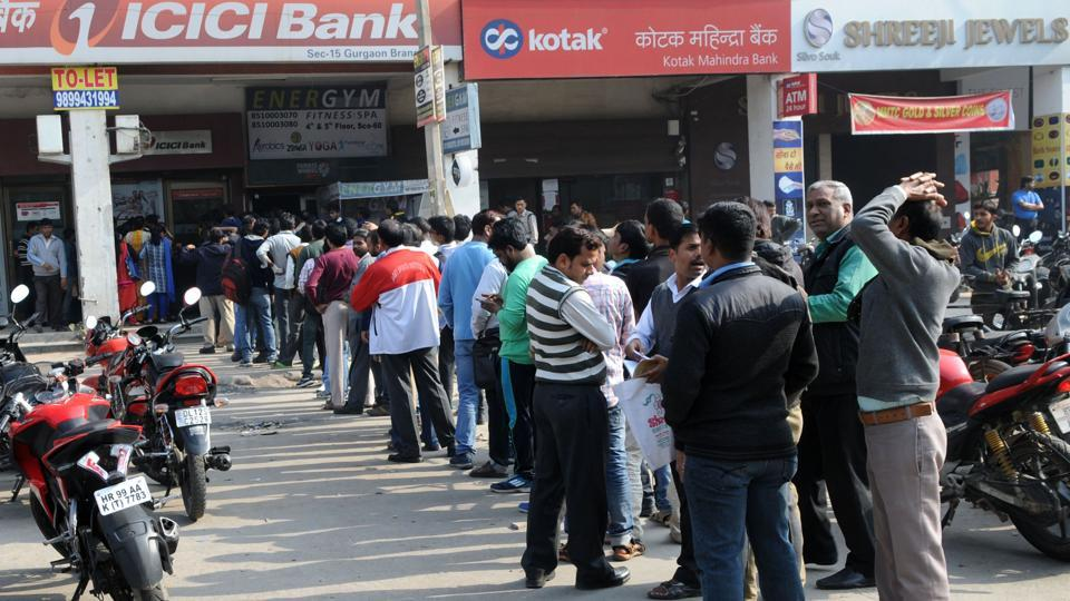 People standing in long queue outside the ICICI Bank civil line branch for withdraw the cash in Gurgaon on Tuesday.