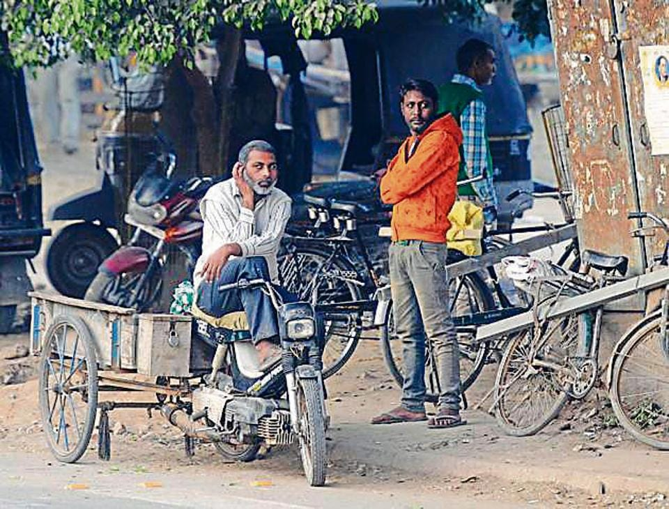 Labourers await jobs at Labour Chowk in Mohali on Tuesday.