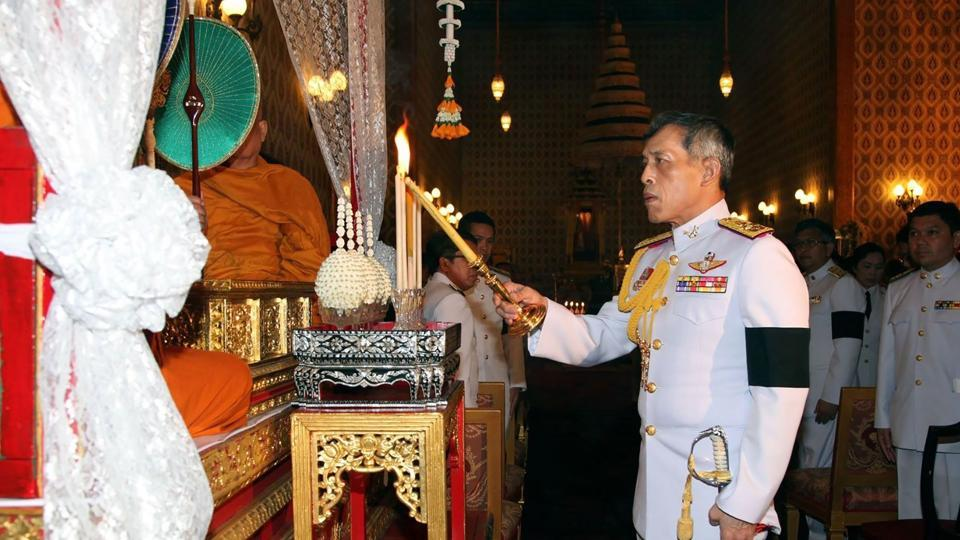 Thailand's new king Maha Vajiralongkorn takes part in a ceremony to pay respects to his late father King Bhumibol Adulyadej in the Grand Palace in Bangkok in October.