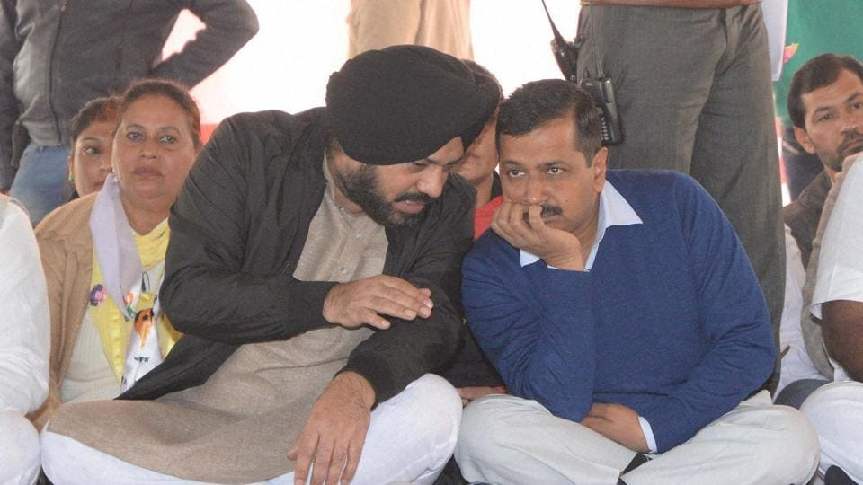 AAP convener Arvind Kejriwal with the party's Punjab unit chief, Gurpreet Singh Waraich 'Ghuggi', during a rally at Adampur in Jalandhar