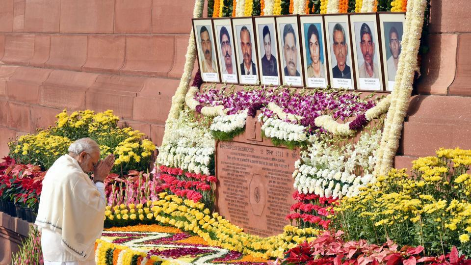 Prime Minister Narendra Modi pays homage to the martyrs on the 15th Parliament attack anniversary at Parliament House. (Arun Sharma/HT )