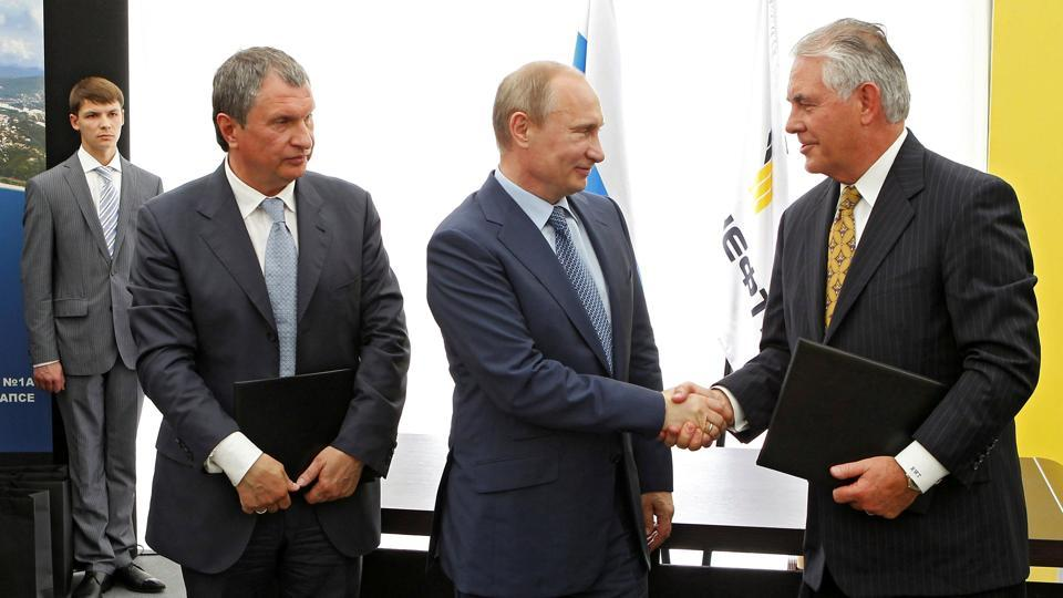 File photo of Russia's President Vladimir Putin, Rosneft chief executive Igor Sechin and ExxonMobil CEO Rex Tillerson at a signing ceremony in the Black Sea town of Tuapse, Russia, on June 15, 2012.