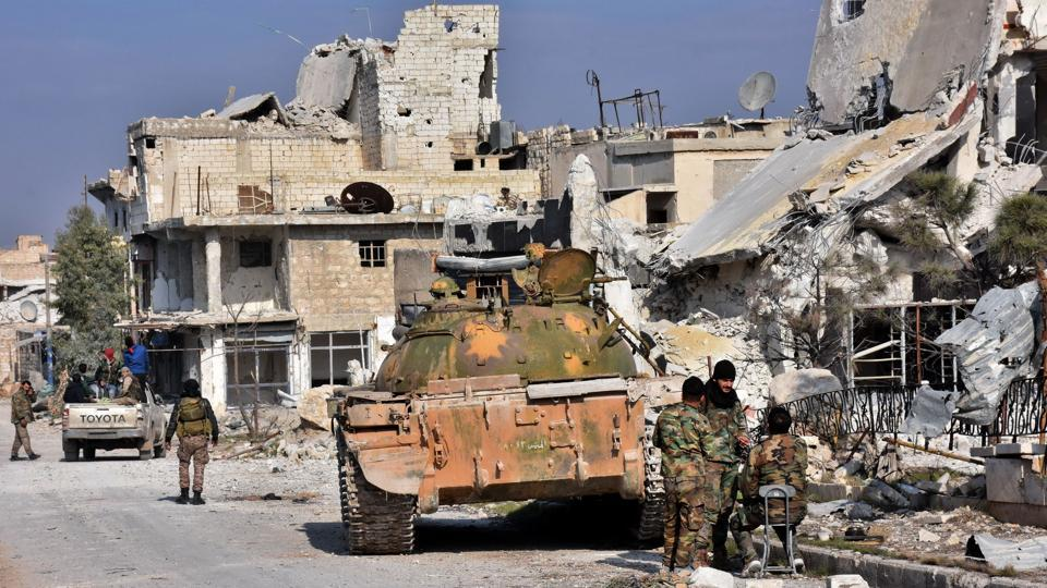 Syrian pro-government forces hold a position in Aleppo's Sheikh Saeed district, on December 12, 2016, after troops retook the area from rebel fighters.
