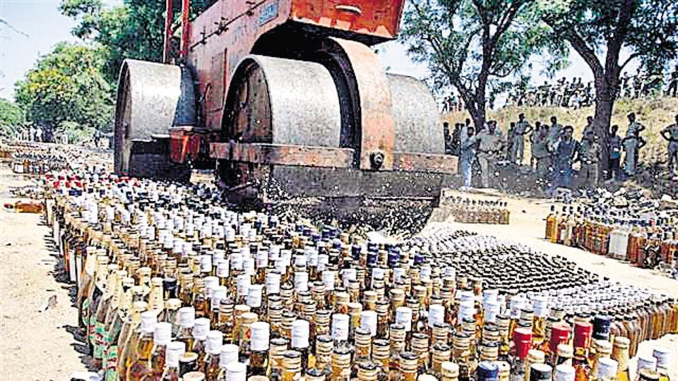 Liquor bottles are crushed under a road roller after the prohibition was announced in Bihar in April.