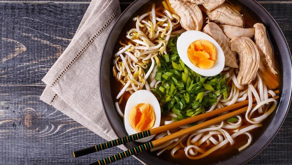 A bowl of Japanese ramen soup with chicken and egg chives