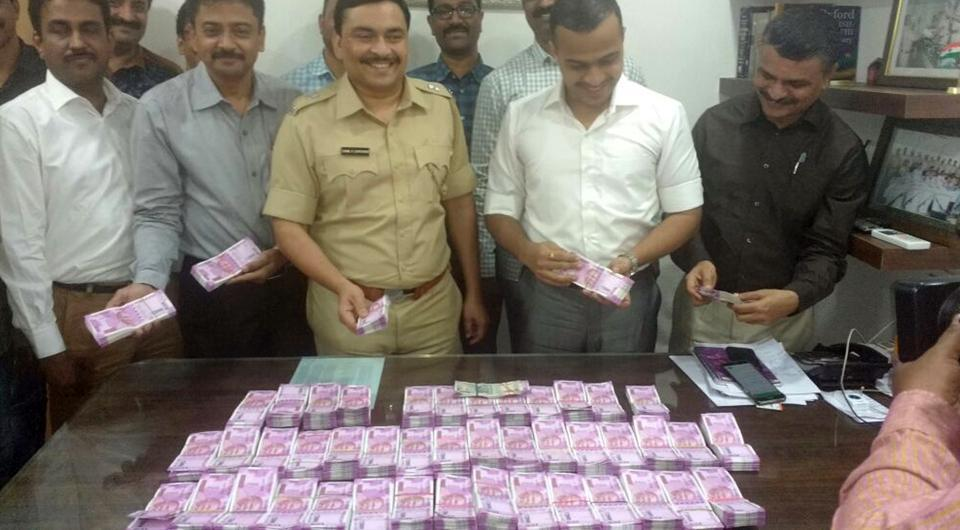 The police with the seized currency.