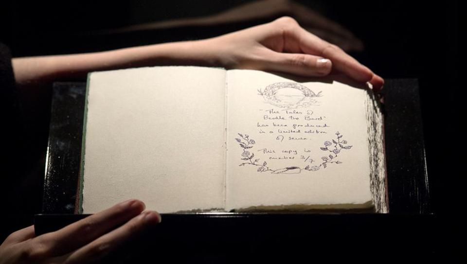 One of only seven copies of a handwritten and illustrated book by British author JK Rowling titled The Tales of Beedle the Bard is on show at Sotheby's auction house in London.