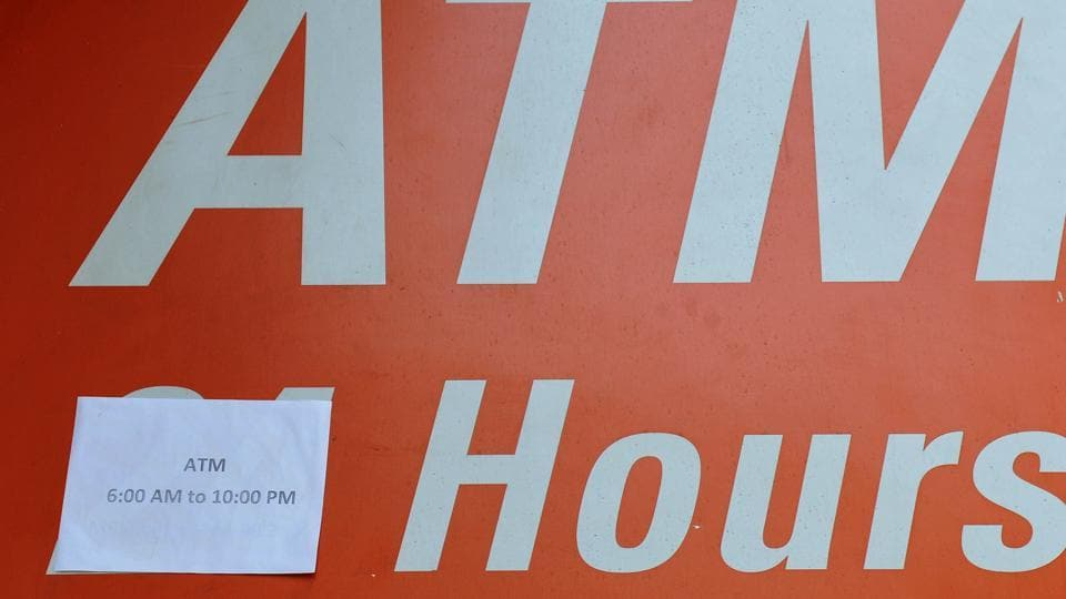 Timings pasted over '24' at an ATM in Chandigarh on Tuesday, December 13. (Ravi Kumar/HT)