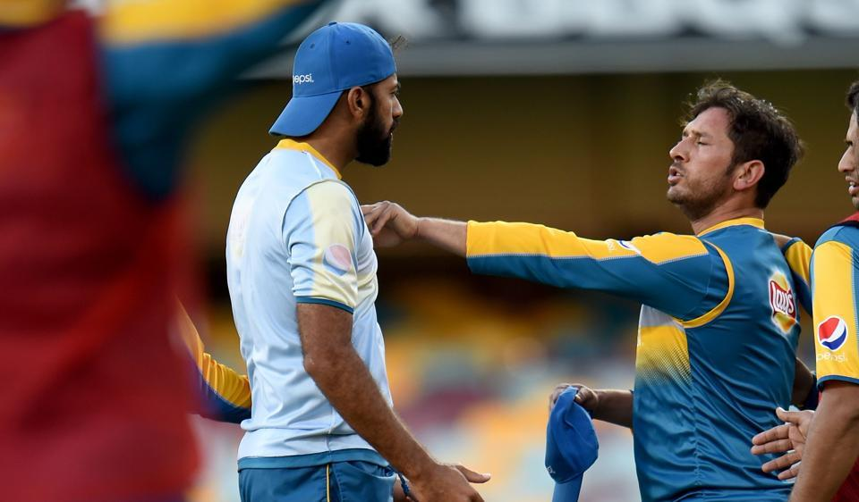 Pakistan players Yasir Shah (right) and paceman Wahab Riaz (left) confront each other during a training session at The Gabba in Brisbane on Wednesday, the eve of their Test against Australia.