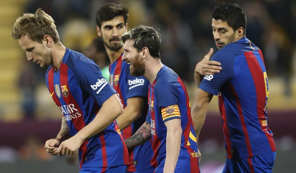 FC Barcelona's Luis Suarez (R), Linonal Messi (C), Ivan Rakitic (L) and André Gomes (2nd L) celebrate a goal against  Al-Ahli.
