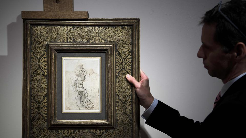 A member of Paris auctioneer Tajan displays a previously undiscovered drawing by Leonardo da Vinci at the auction house in Paris on Tuesday.