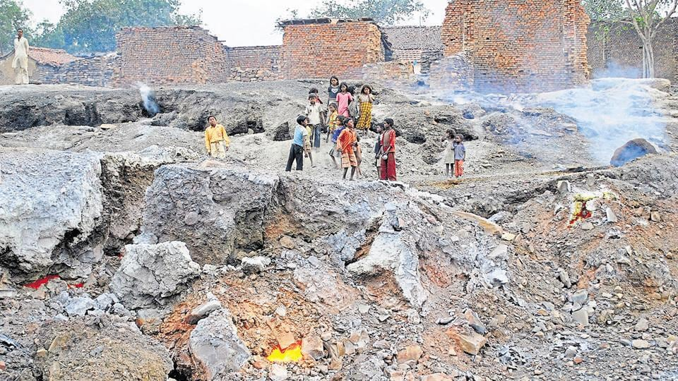 Kids of Lodhna colony play on the area affected by underground fire in Dhanbad.