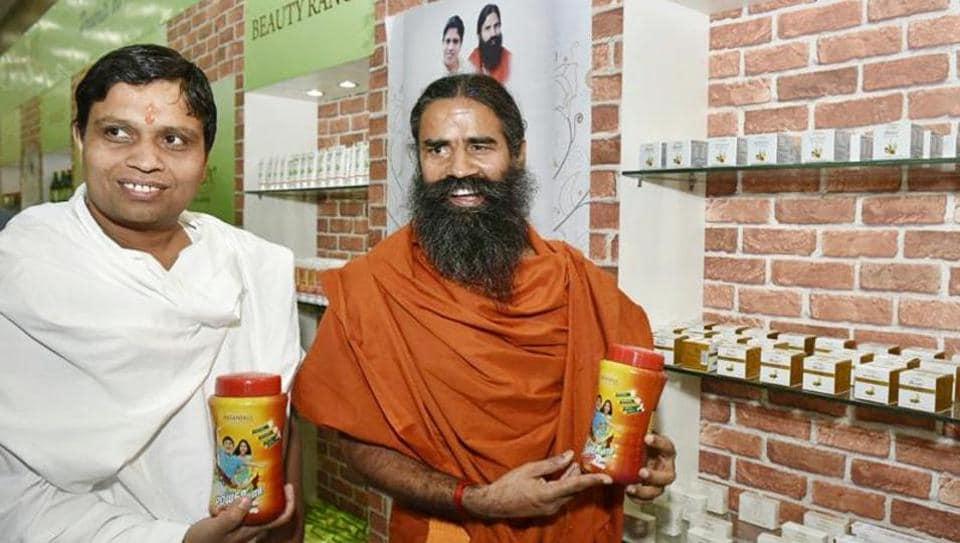 "Yog Guru Baba Ramdev and Acharya Balkrishna showing their ""Patanjali"" products before addressing a Press Conference in New Delhi on Tuesday, April 26, 2016."