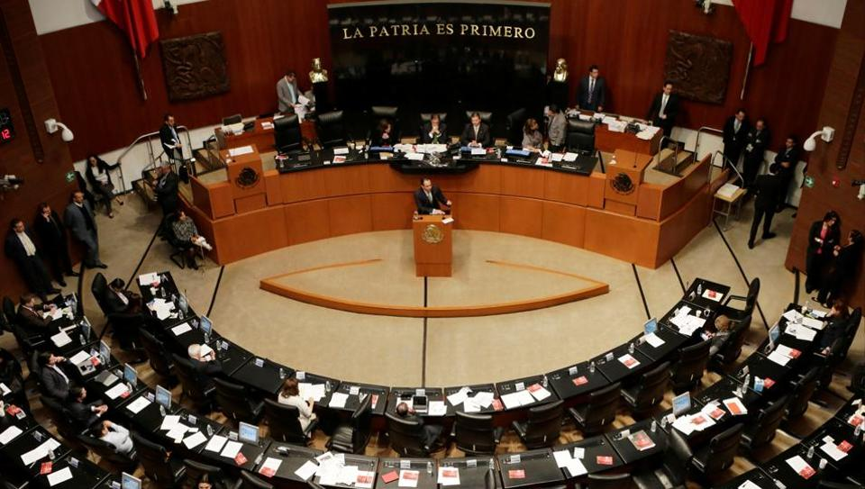 Mexico's Senator Roberto Gil Zuarth (at podium) addresses fellow senators as Mexico's senate approved a bill on Tuesday that would allow for the import and eventually, production, of medical marijuana in Mexico, in Mexico City on Dec 13.