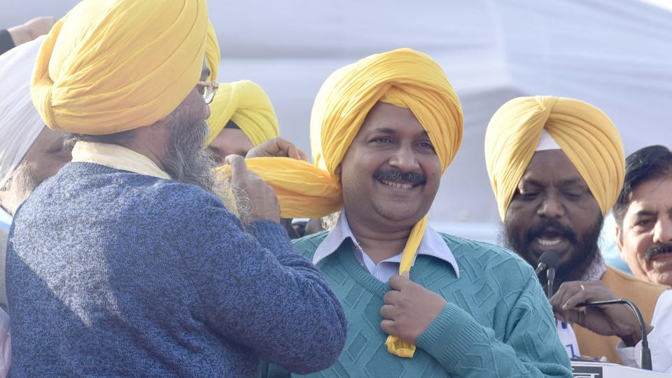 AAP leaders tying a turban on party convener and Delhi CM Arvind Kejriwal's head at Majitha in Amritsar district on Wednesday, December 14.