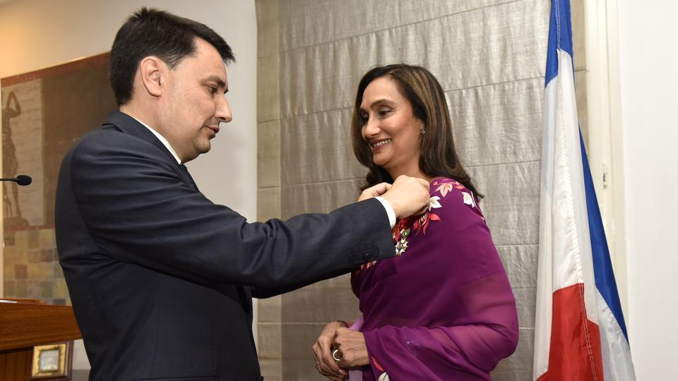 The ambassador of France, Alexandre Ziegler, confers his country's highest civilian award on Shobhana Bhartia, the chairperson and editorial director of HT Media Ltd, in New Delhi on Wednesday.
