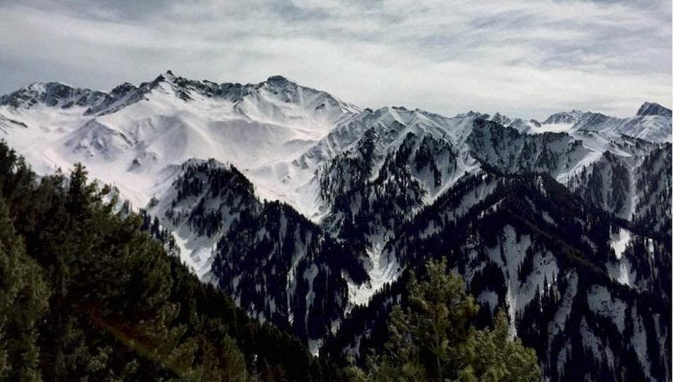 A view of snow-covered upper reaches of Peer Panchal Range as pictured from Poonch in Jammu and Kashmir on Friday.  (PTI)