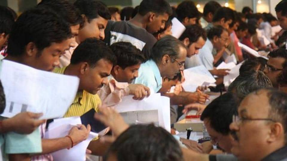 People submit their Income tax return form at Pragati Maidan in New Delhi.