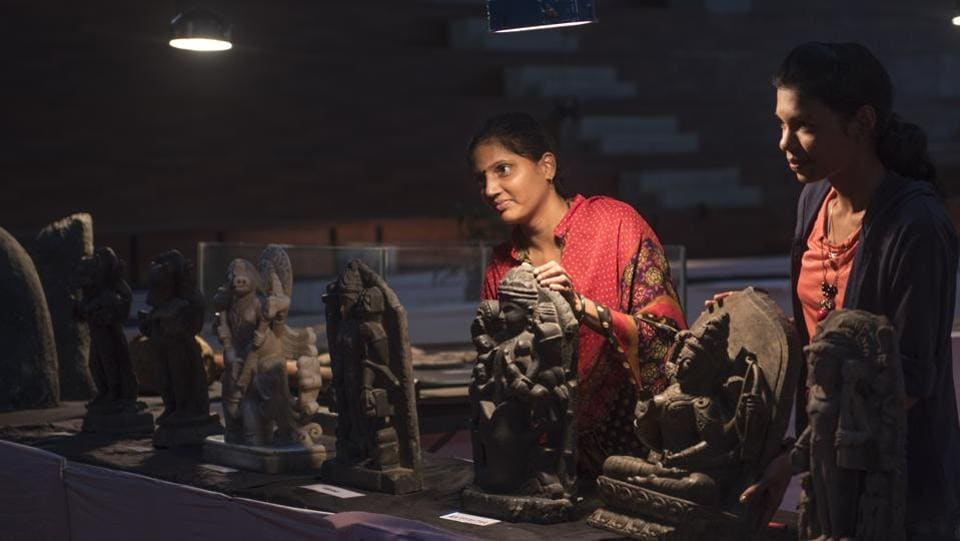 Bringing facts to light: People put the artefacts in order. (SATISH BATE/HT PHOTO)