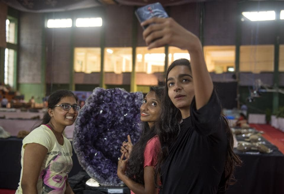 Blending the old with the new: Youngsters take a selfie at the Archaeology and Geology exhibition at Kalina campus of Mumbai University. The exhibition is open till December 18.  (SATISH BATE/HT PHOTO)