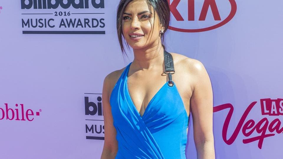 At the Billboard Music Awards in a blue figure-hugging dress. (Shutterstock)