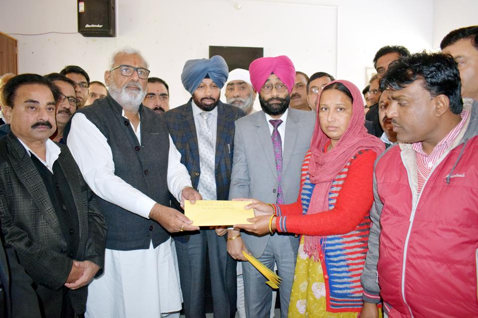 State health minister Surjit Kumar Jiyani handing over an appointment letter to one of the family members in Fazilka on Wednesday.