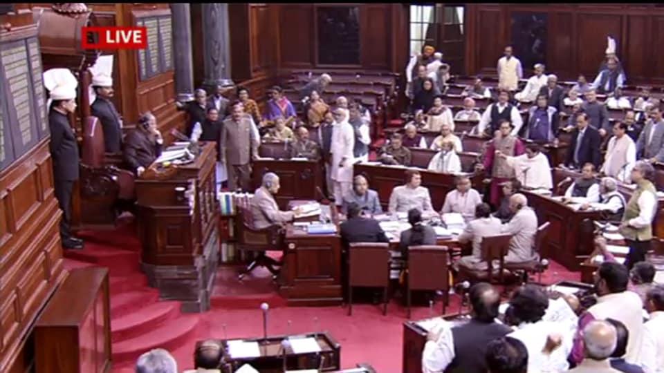 Rajya Sabha members protest in the House over the Centre's move to demonetise currency.
