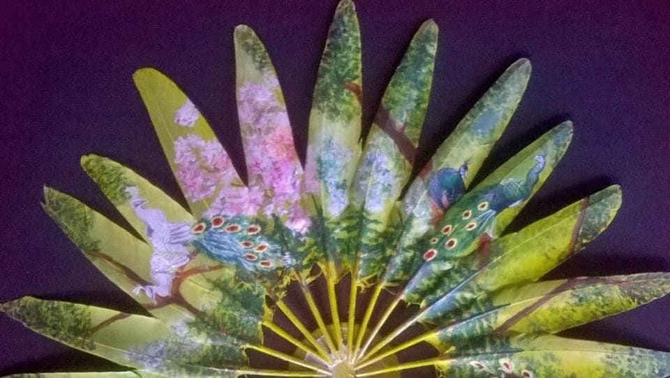 An array of painted feathers which looks like a hand fan. (Aditi Agarwal)