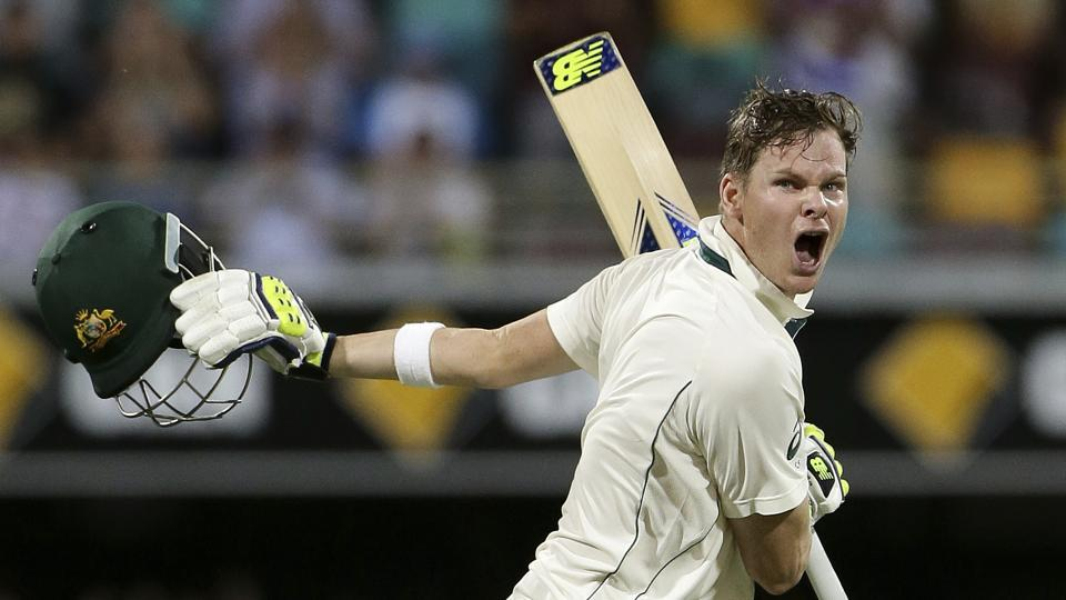 Australia's Steve Smith reacts as he celebrates after scoring a century against Pakistan in Brisbane.