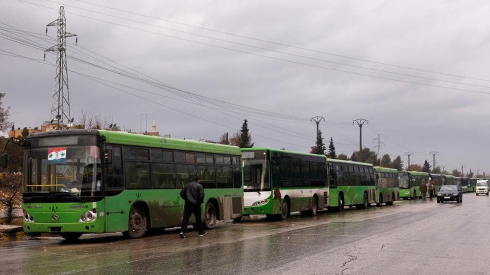 Buses wait to evacuate people from a rebel pocket in Aleppo, in the government-controlled al-Hamadaniah Stadium of Aleppo, Syria December 14.