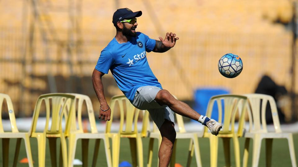 India's captain Virat Kohli plays football with teammates. (AFP)