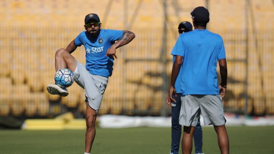 Indian captain Virat Kohli plays with teammates during a training session. (AFP)