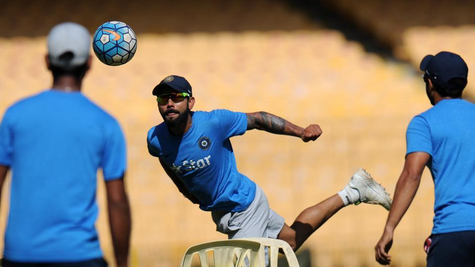 Indian captain Virat Kohli warms up with teammates during a training session ahead of the fifth cricket Test match between India and England. (AFP)