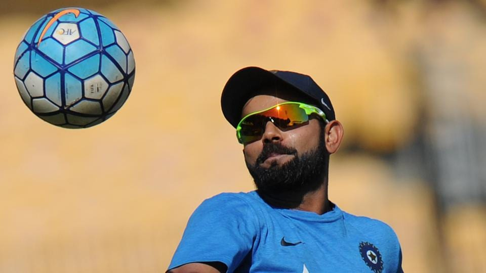 Indian captain Virat Kohli plays football during a training session ahead of the fifth cricket Test match between India and England.