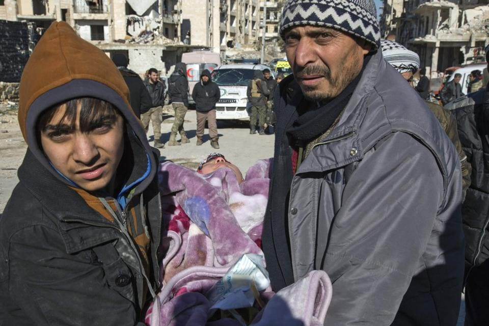A Syrian child being carried for the evacuation operation. The rebel withdrawal will pave the way for President Bashar al-Assad's forces to reclaim complete control of Syria's second city, handing the regime its biggest victory in more than five years of civil war.  (AFP)